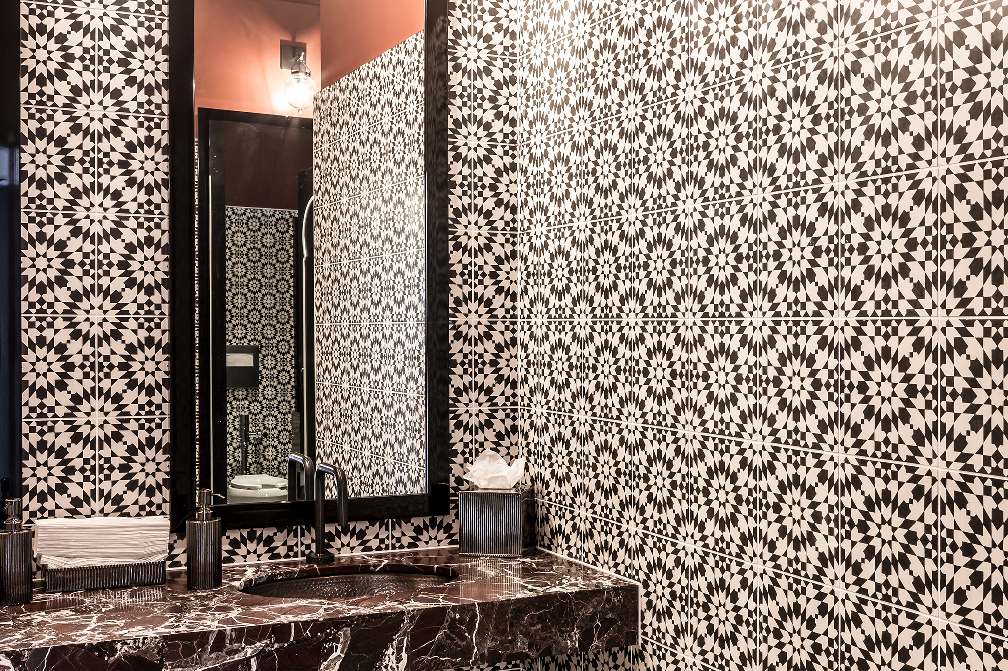 bathroom wall installation at the hotel californian shows versatility and wide range of available indochine patterns artillo spanish cotto concrete tile